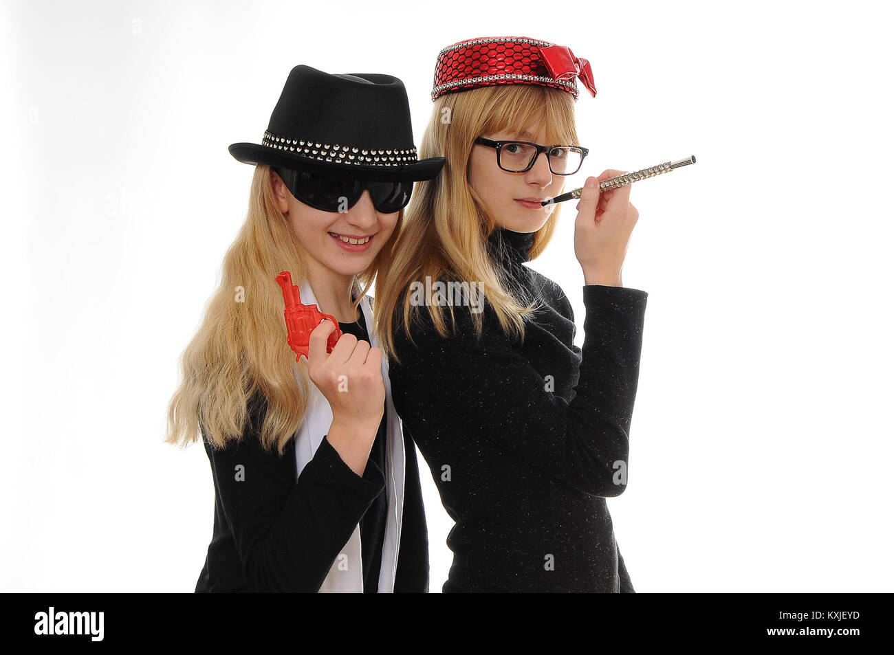 two pretty blonde Caucasian girls dressed as Gangster and Moll, isolated on white - Stock Image