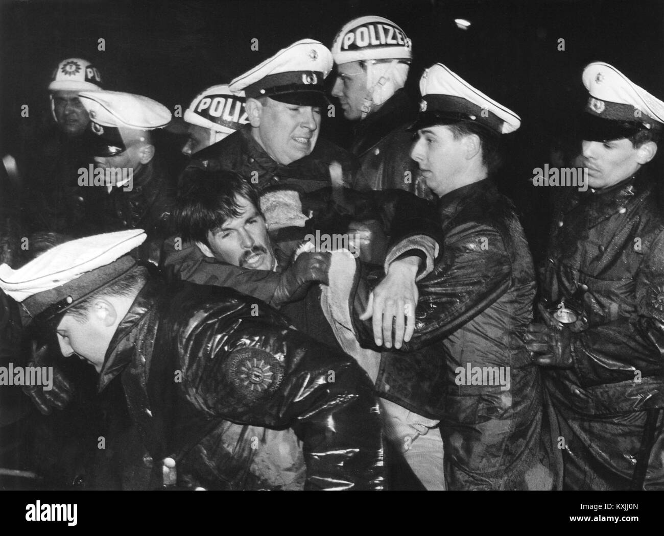 The police during the arrest of a young protester. On April 6,1967, during a demonstration in front of the Springer - Stock Image