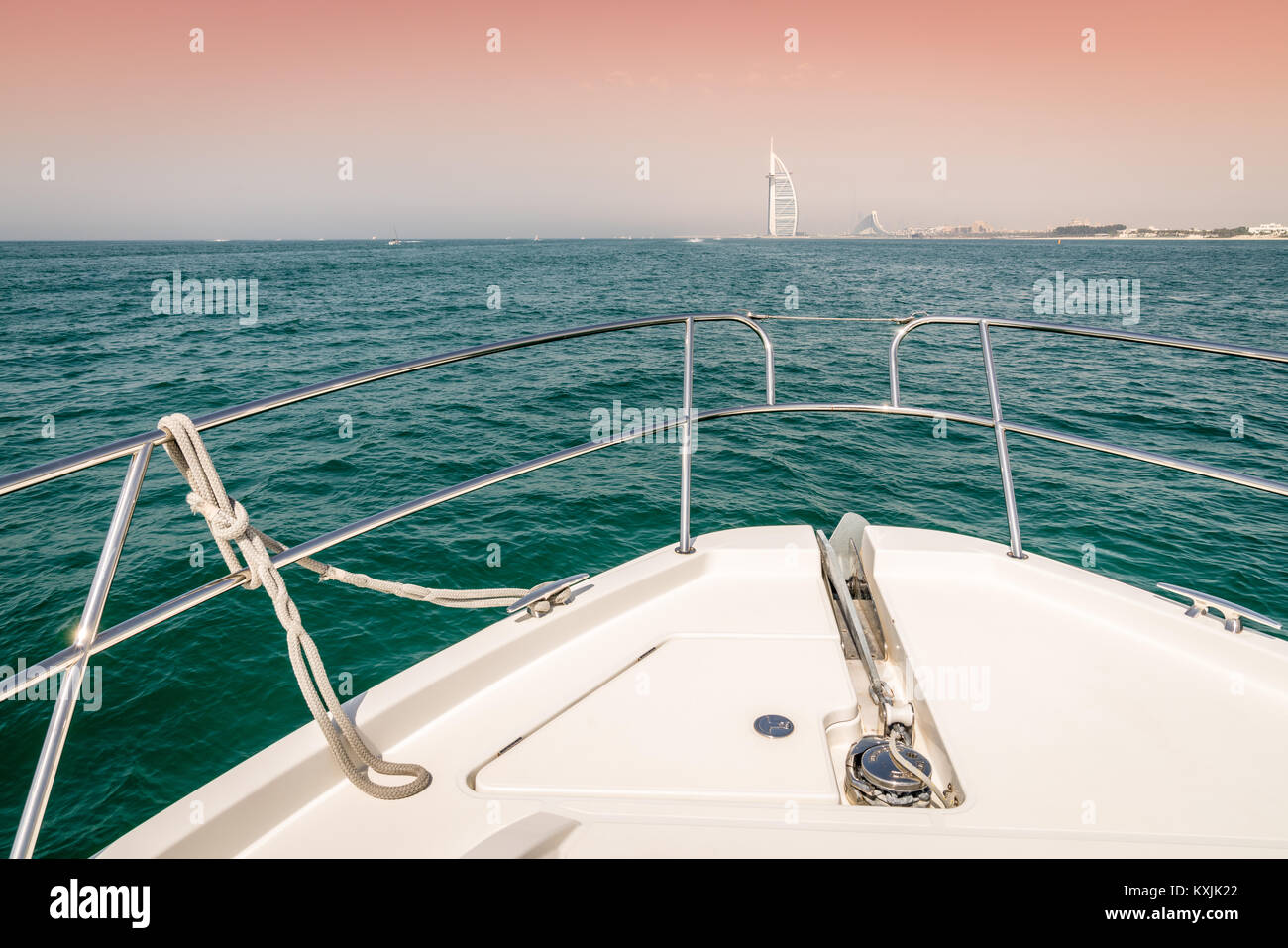 View of Dubai coast from the bow of a yacht - Stock Image