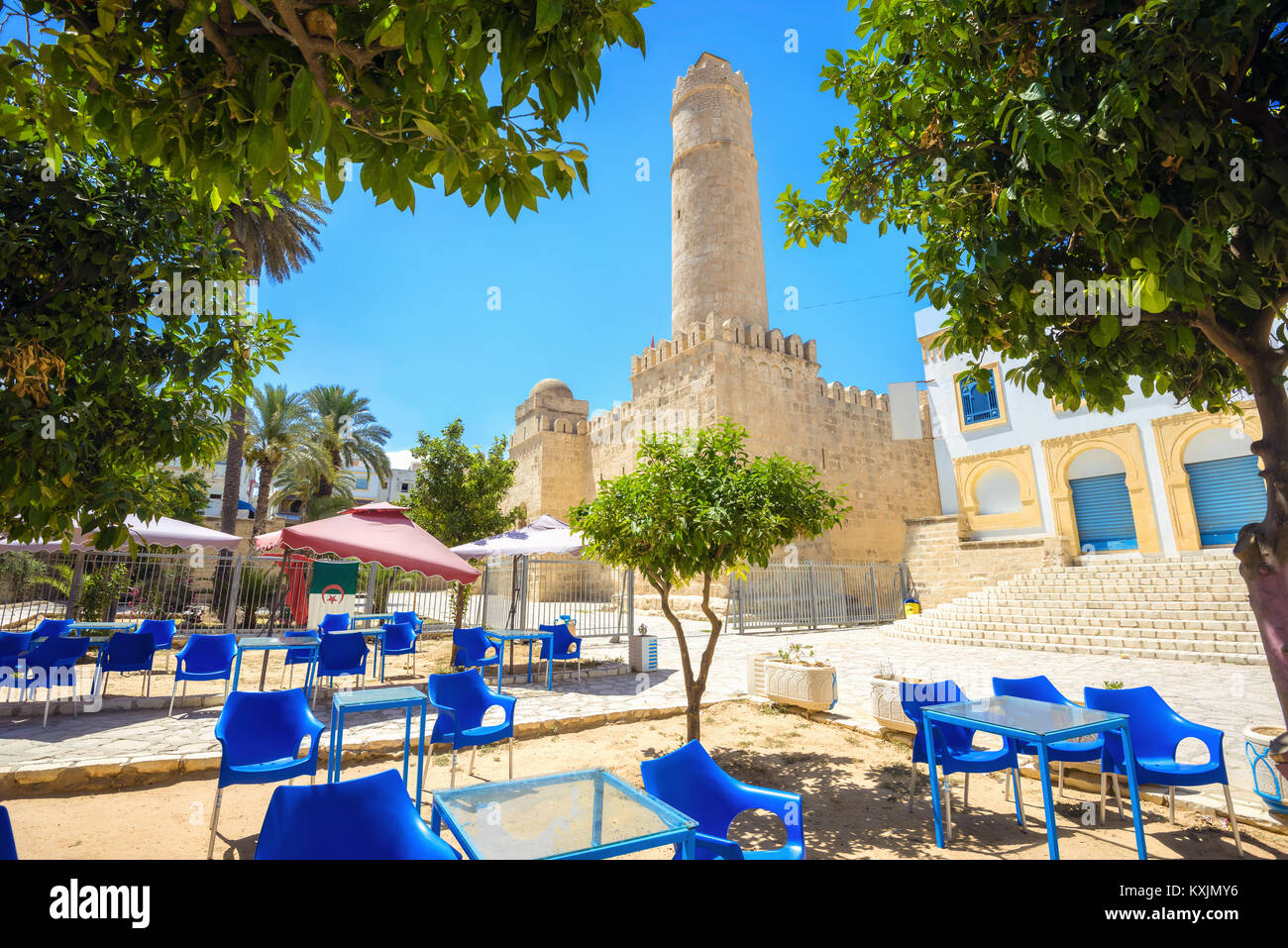 Cityscape with street cafe and view of ancient fortress in Sousse. Tunisia, North Africa - Stock Image