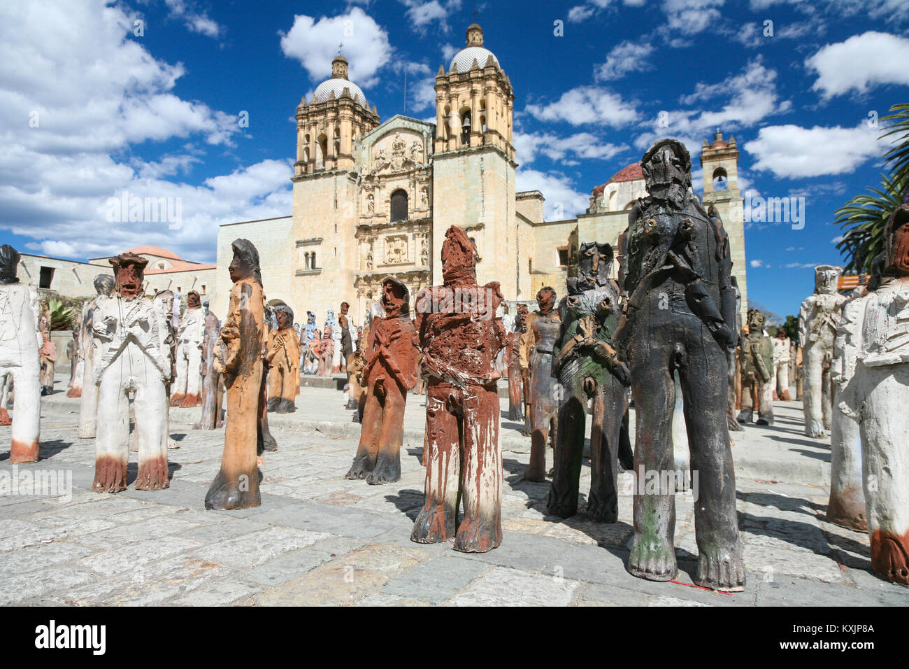 OAXACA, MEXICO - MARCH 7th, 2012: Sculpture art installation in front of the facade of the Church of Santo Domingo Stock Photo