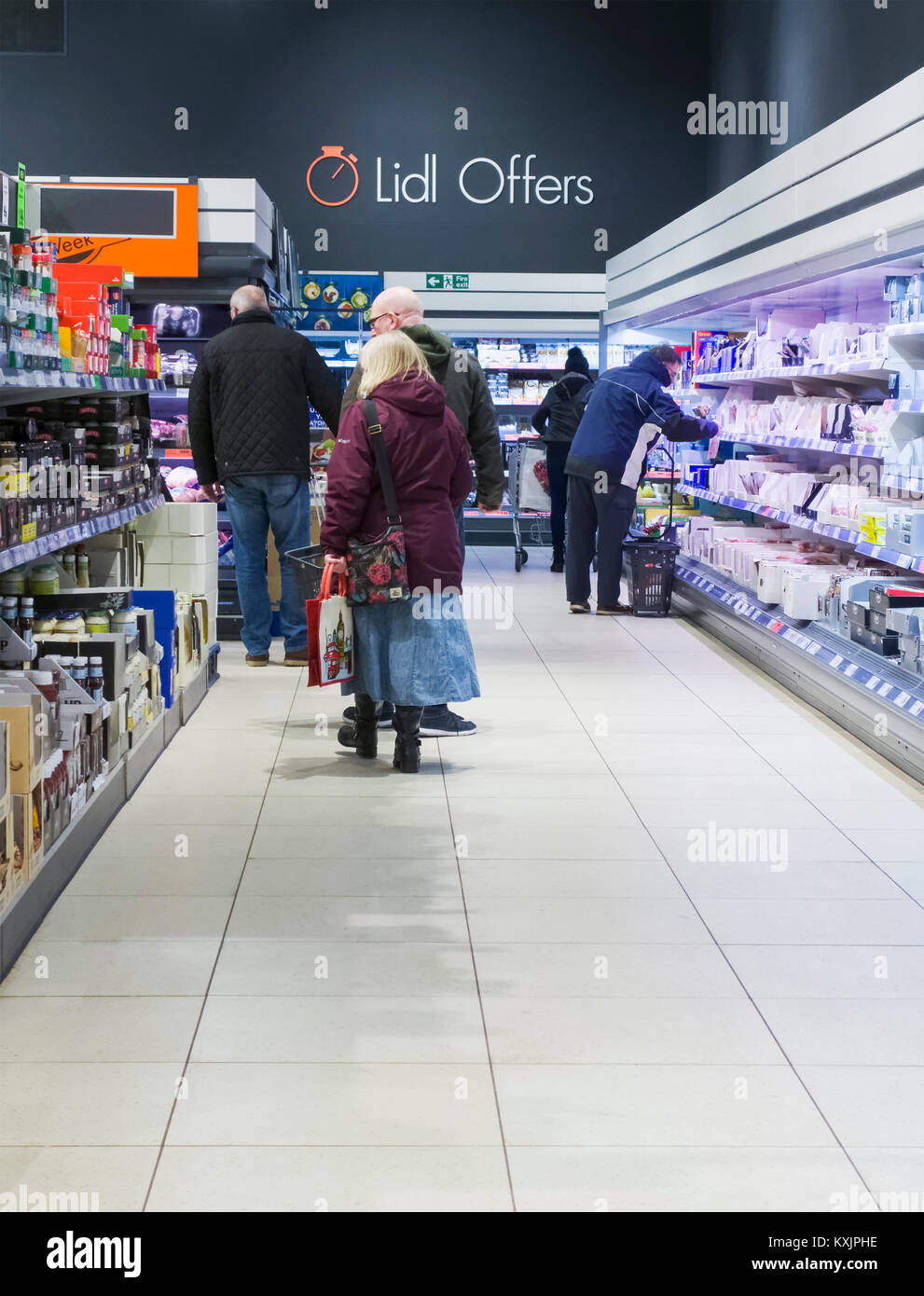 Interior of Lidl supermarket in the UK showing aisles and customers choosing goods and produce. - Stock Image
