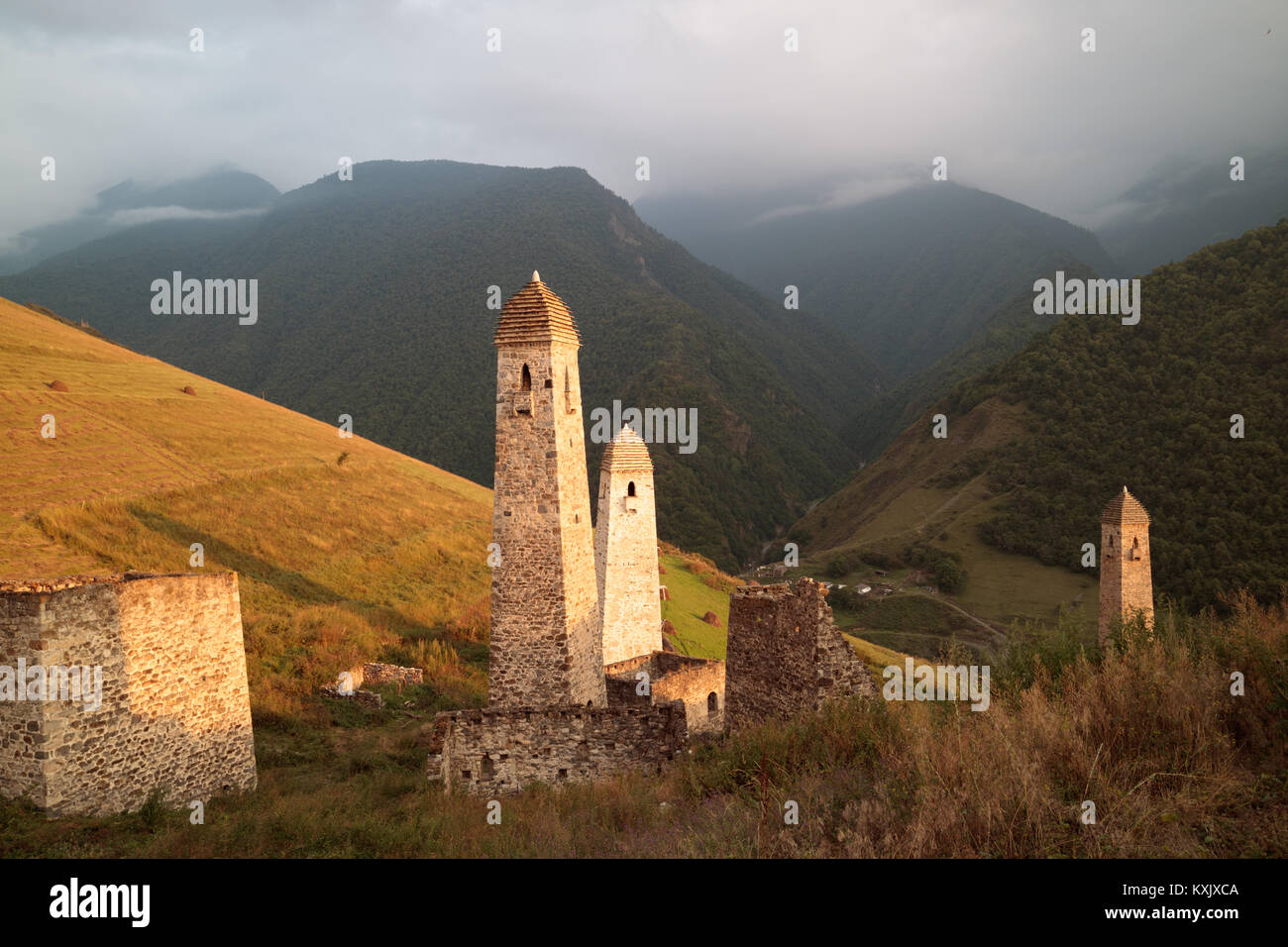 Golden sunset in Chechen/Ingush mountains, Erzi medieval architecture, North Caucasus Stock Photo