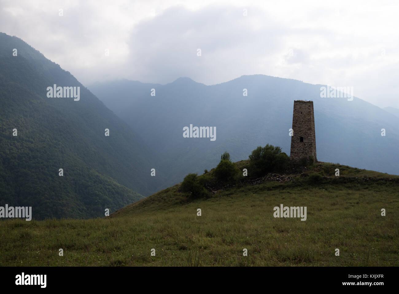 Caucasian military medieval tower (watchtower) at sunset, Dzheyrakh - Stock Image