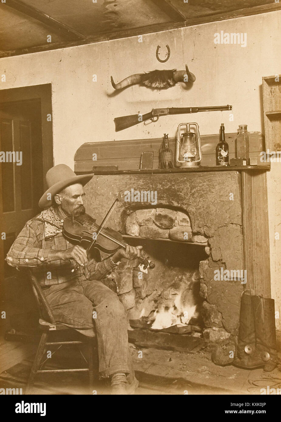 Fireplace Fiddler - Stock Image