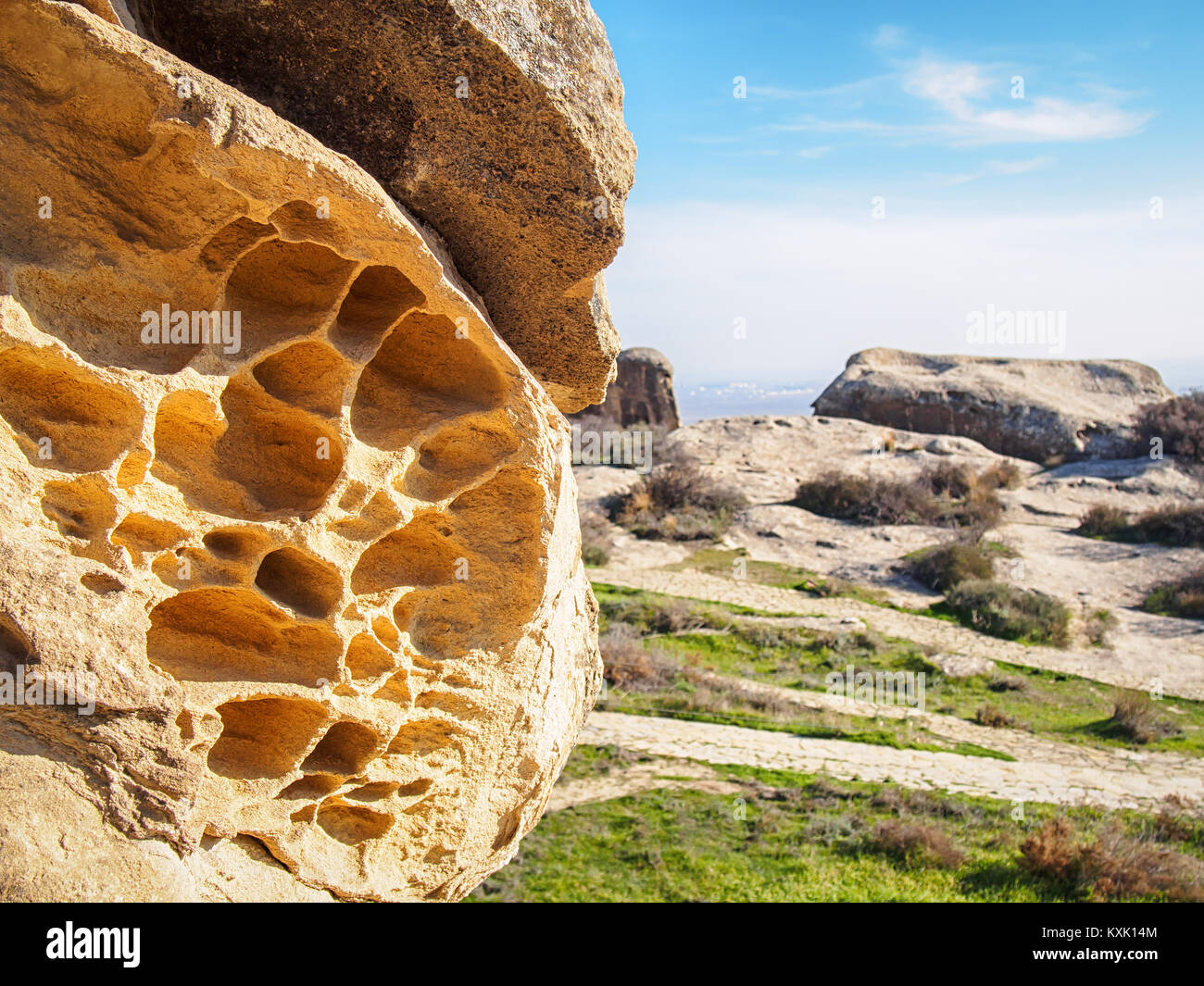 Perforated chalk-stone rock in the Gobustan National Park, Azerbaijan - Stock Image