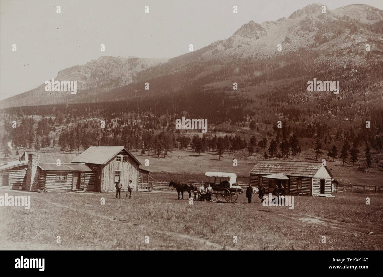 Mud Wagon/ Stagecoach At Log Cabins, Ca. 1880S - Stock Image