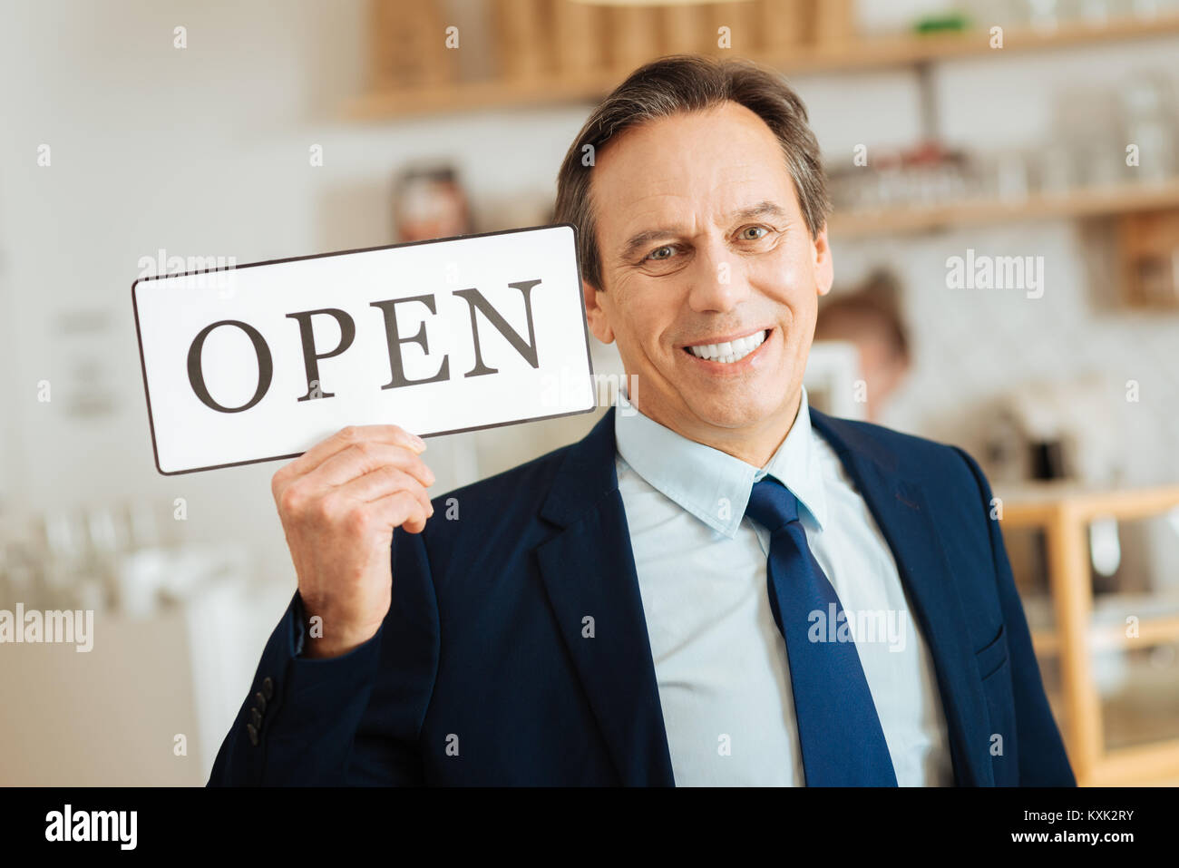 Satisfied pleasant man rejoicing and smiling. Stock Photo
