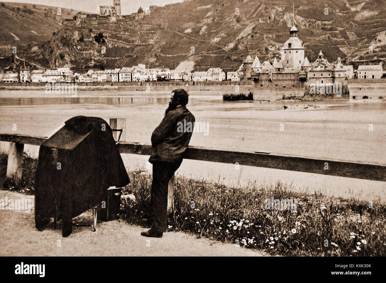 Cameraman with Potable Camera along the Rhine - Kaub - Stock Image