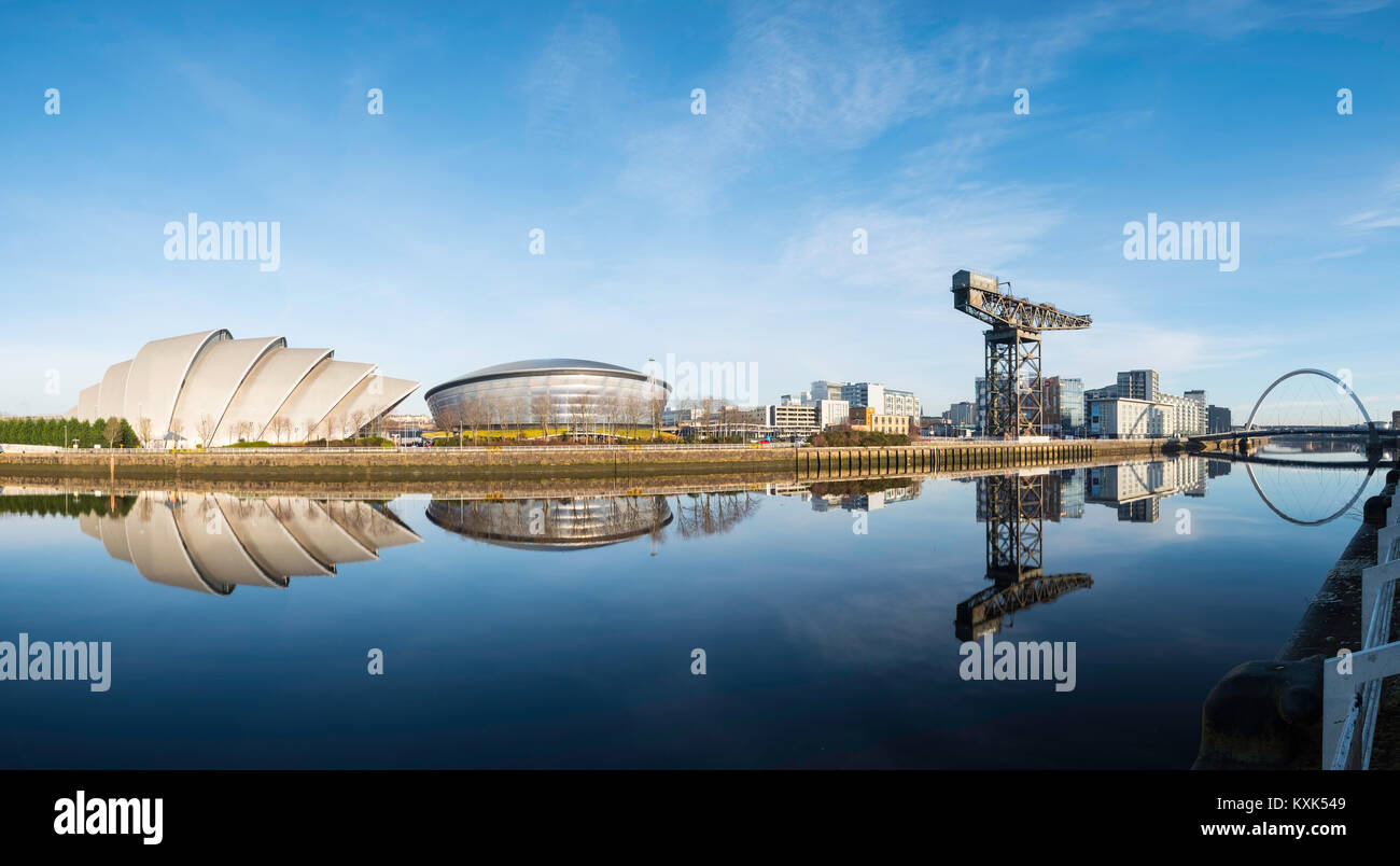 View of SEC Armadillo and SE Hydro beside River Clyde on blue sky winter day, Scotland, United Kingdom - Stock Image