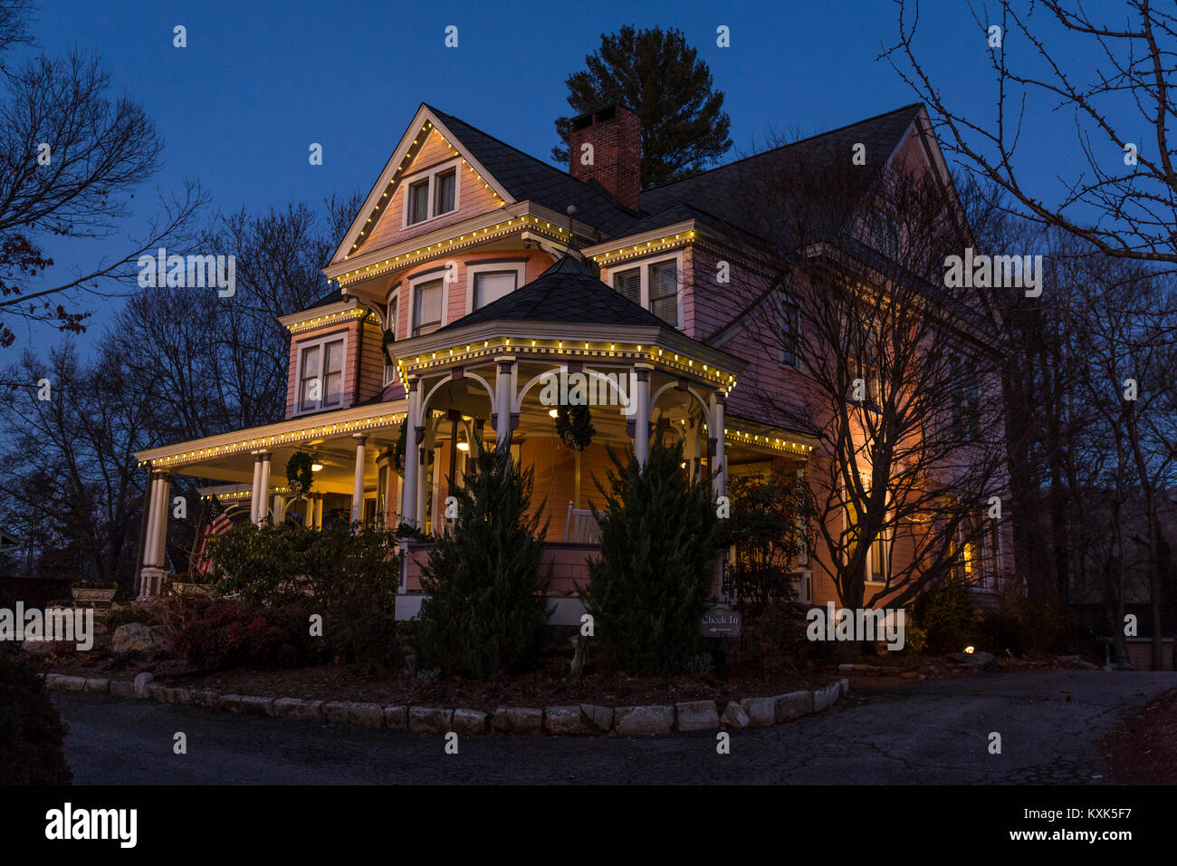 Dusk sets over an elegant Queen Anne Victorian property in Asheville, NC. - Stock Image