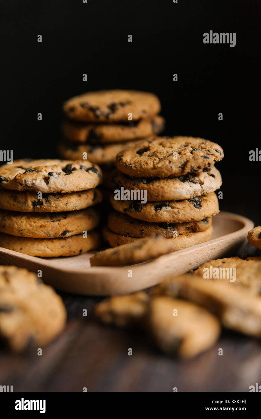 Close-up of cookies in tray on table against black background - Stock Image