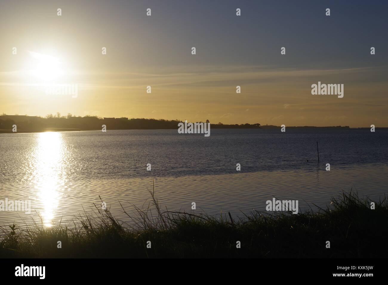 Sunrise over the Exe Estuary at High Tide from Topsham. Devon, UK. January, 2018. Stock Photo