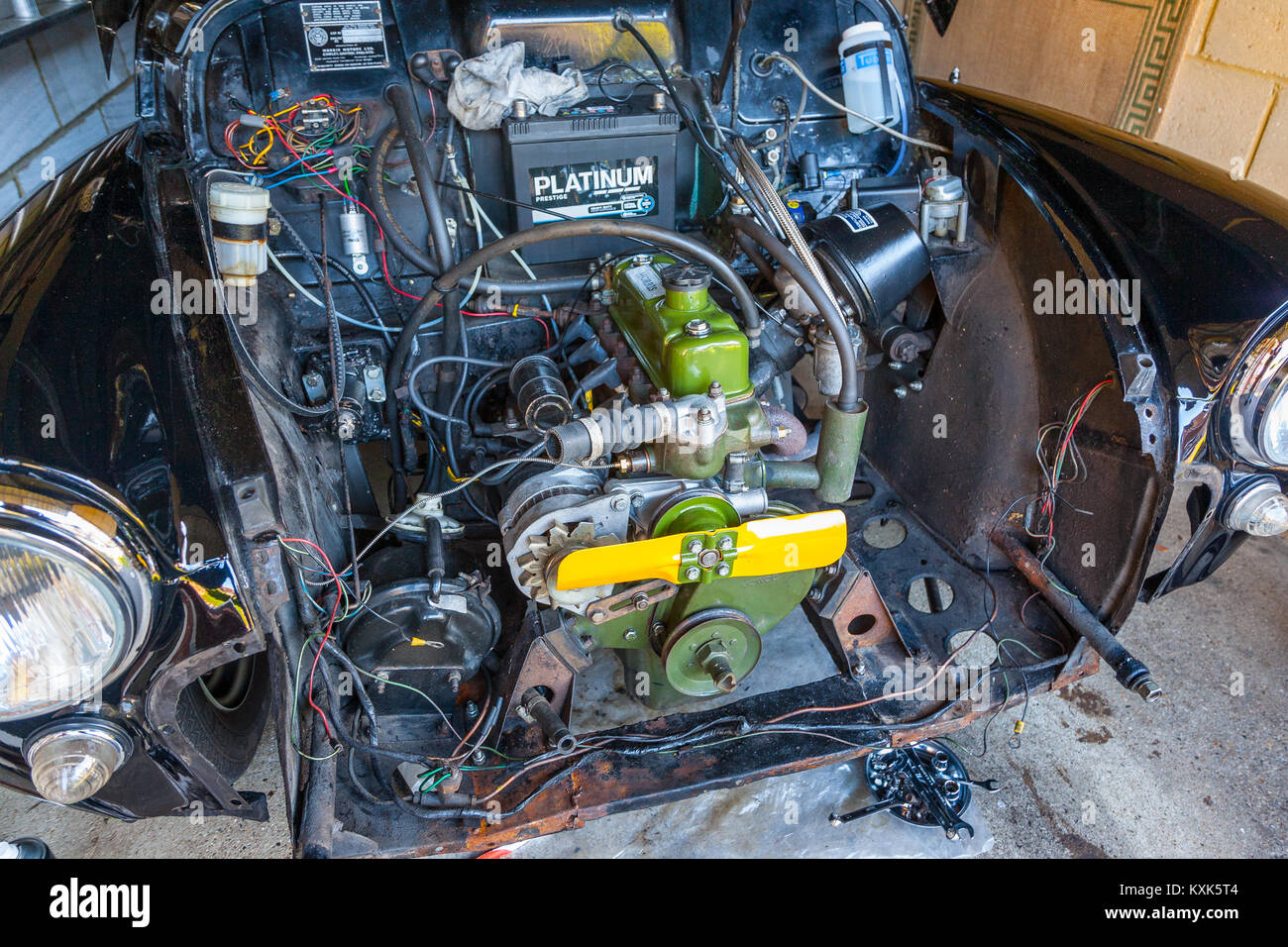 The engine bay of a 1957 Morris Minor classic car - Stock Image
