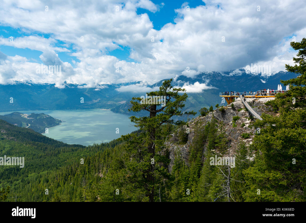 Panoramic outlook over the BC coastal mountain range and howe sound with sky pilot sunspension bridge and viewing - Stock Image