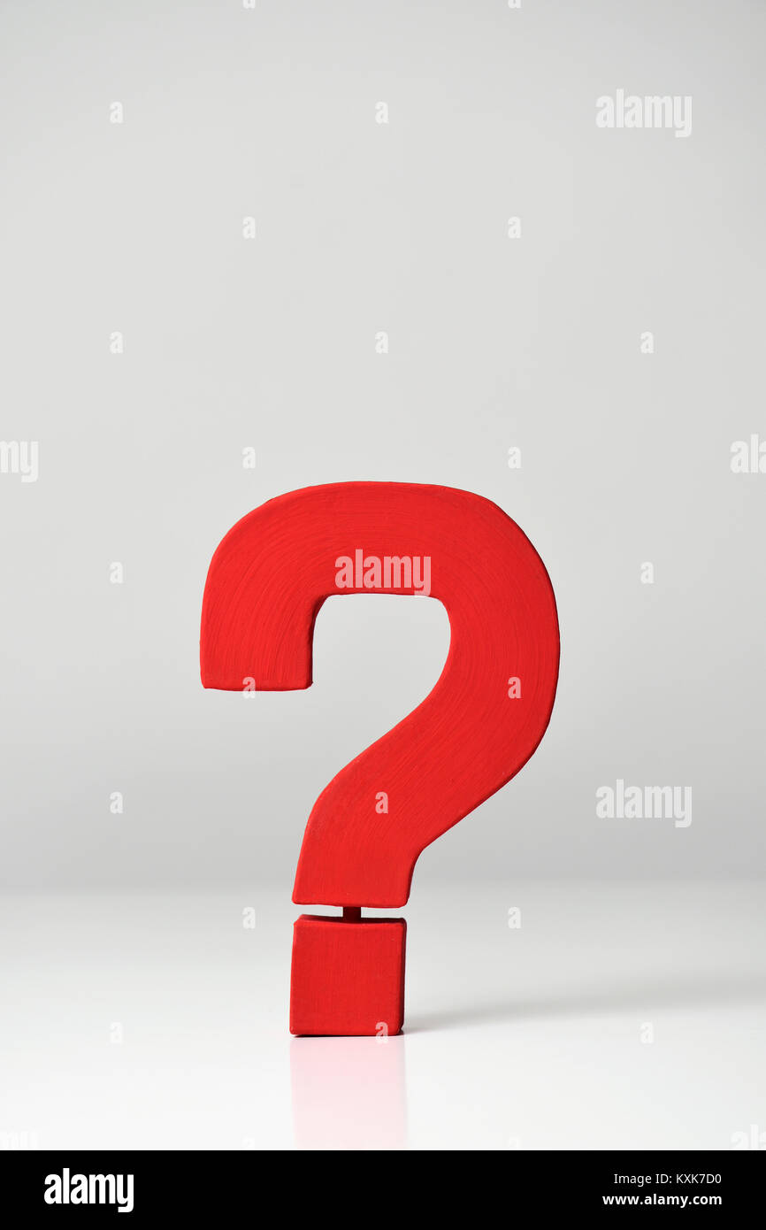a red three-dimensional question mark on an off-white background, with a blank space on top - Stock Image