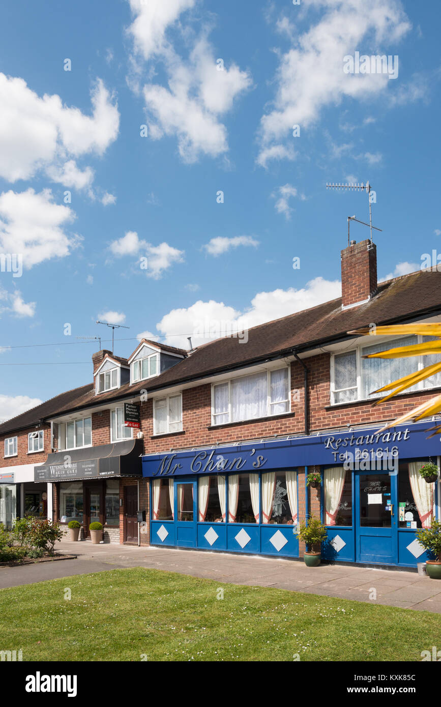 A Chinese takeaway and shop fronts in Tiddington, near Stratford-upon-Avon, Warwickshire, England, UK, Europe - Stock Image