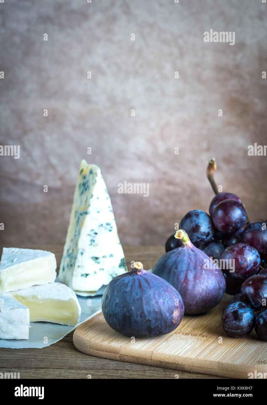 Camembert, figs and grapes - Stock Image