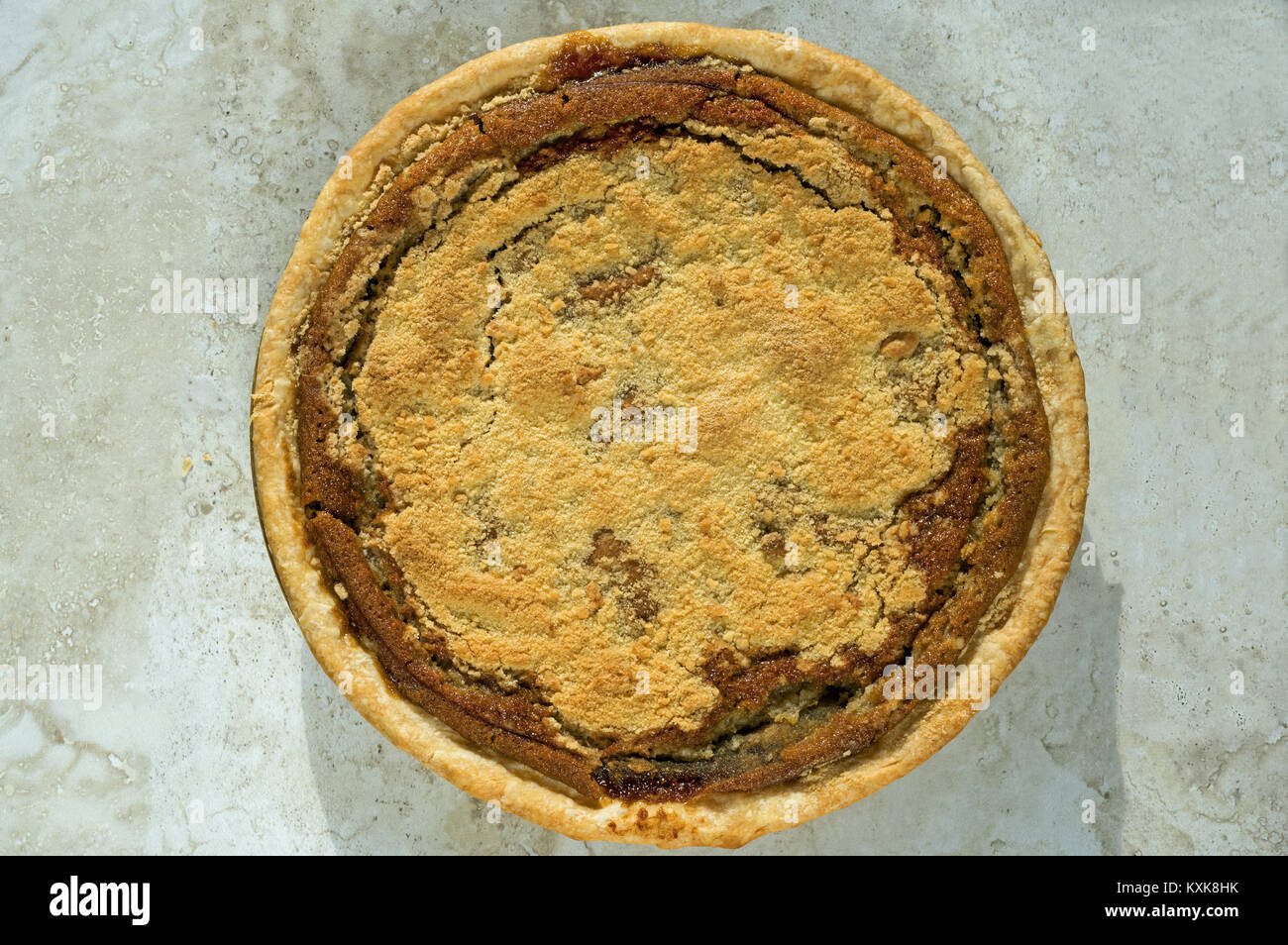 Freshly baked shoofly pie with sugar and molasses. - Stock Image