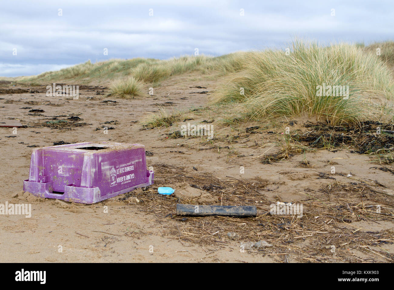 Plastic bottles and waste beach debris washed up on shore on the beach at Southport in Merseyside - Stock Image