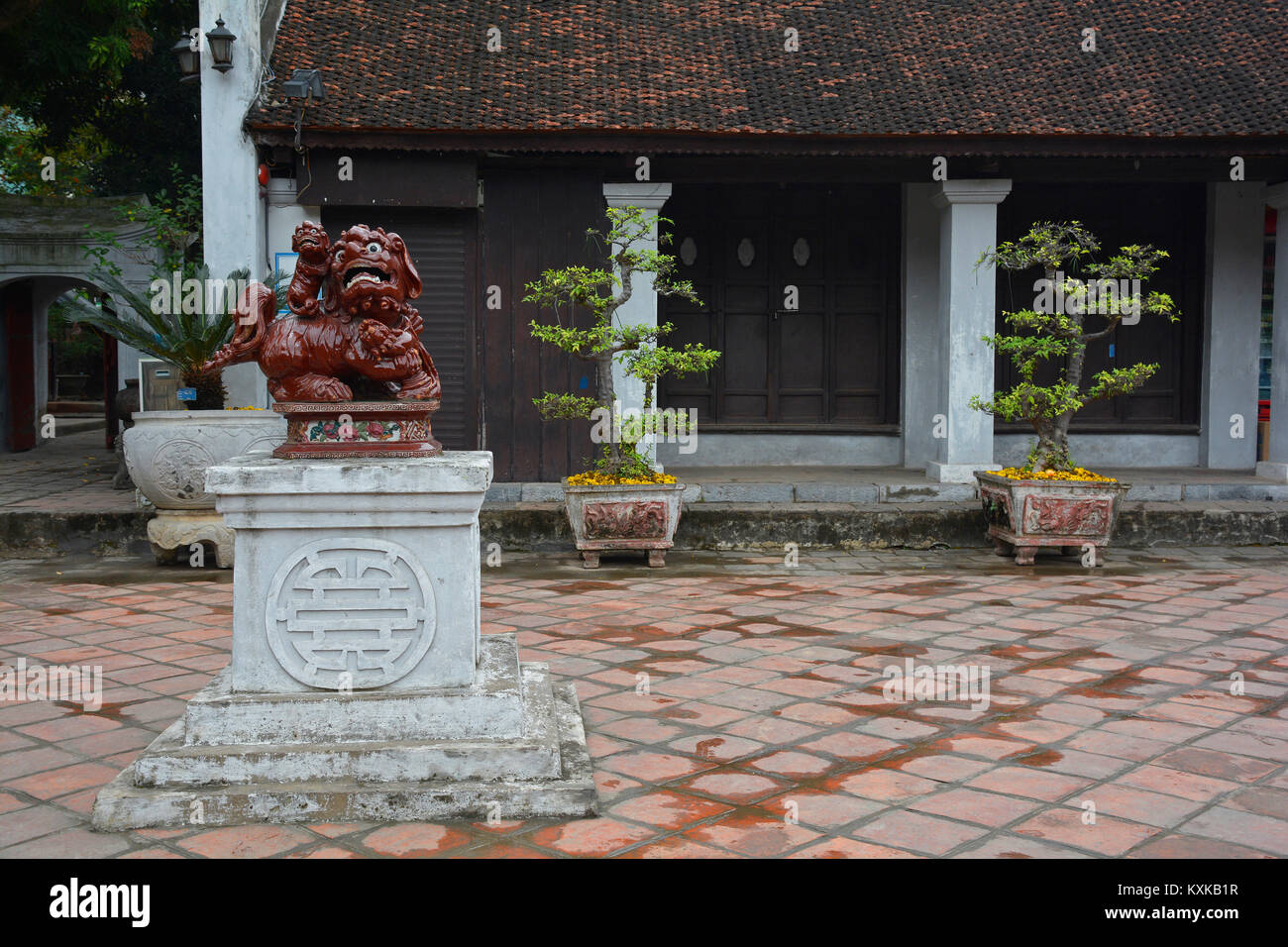 A Guardian Lion, also called a Foo Dog, in the Temple of Literature in Hanoi, Vietnam - Stock Image