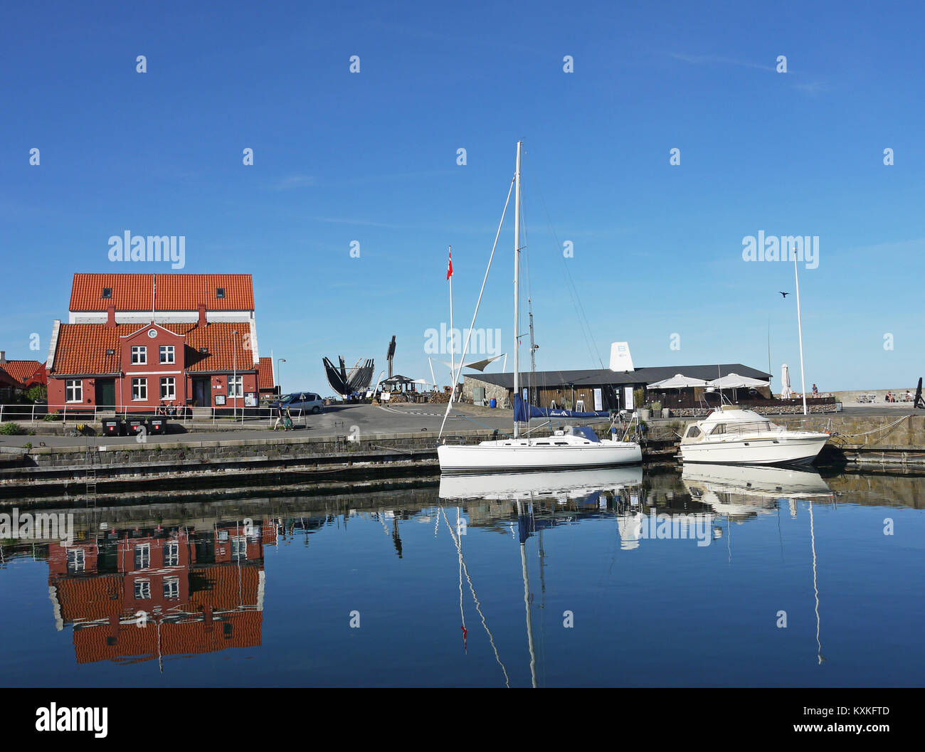 General view of the harbour at Svaneke on the Danish holiday island of Bornholm.  The central red house is the harbour Stock Photo