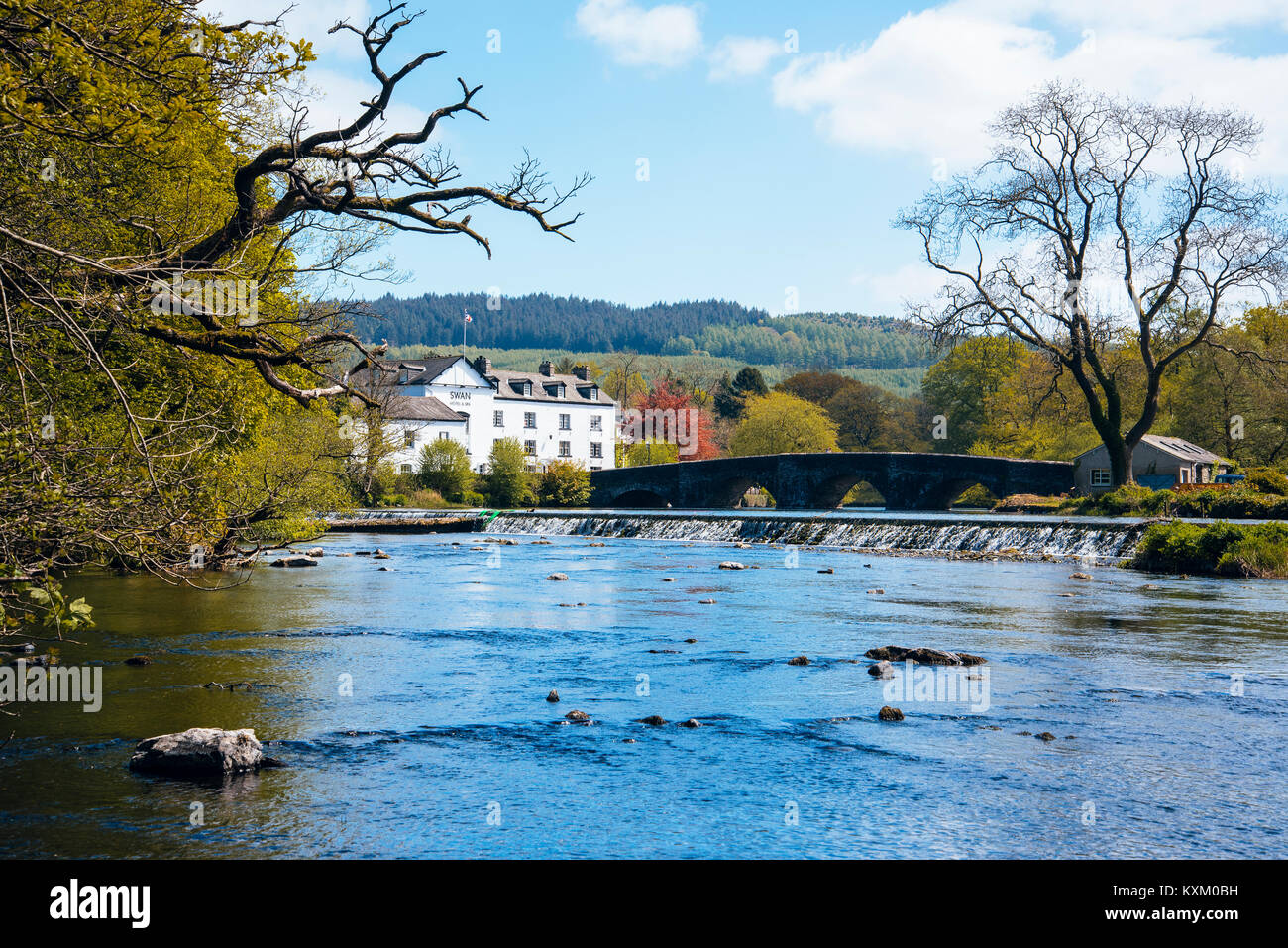 River Leven and Swan Hotel at Newby Bridge in the English Lake District - Stock Image