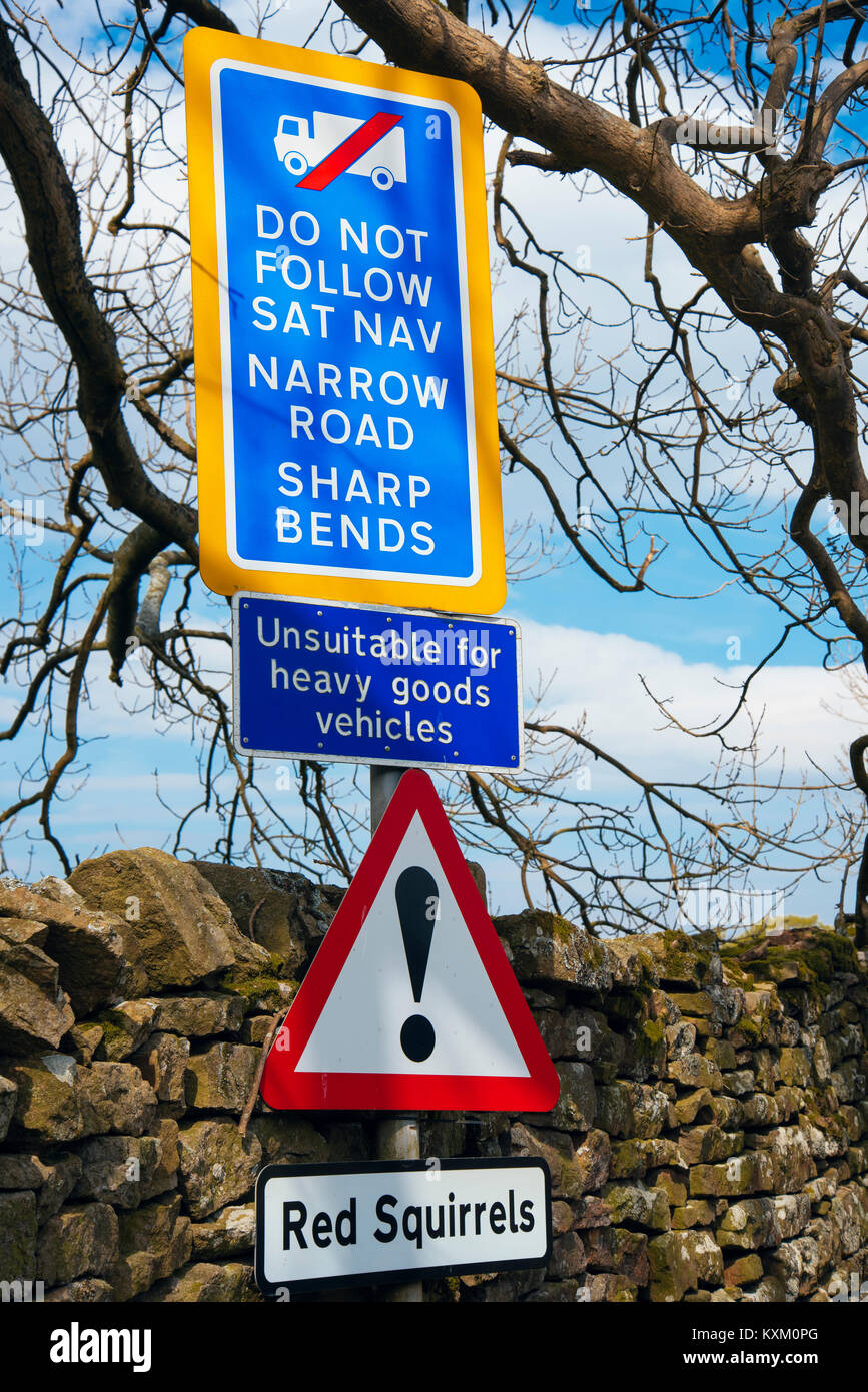 Multiple signs on lane near Pendragon Castle in Mallerstang valley, Cumbria - Stock Image