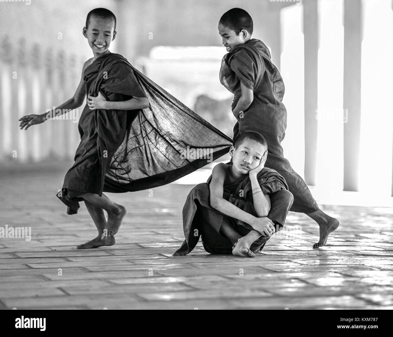 Novice Monks having fun in temple corridor, Bagan, Myanmar - Stock Image