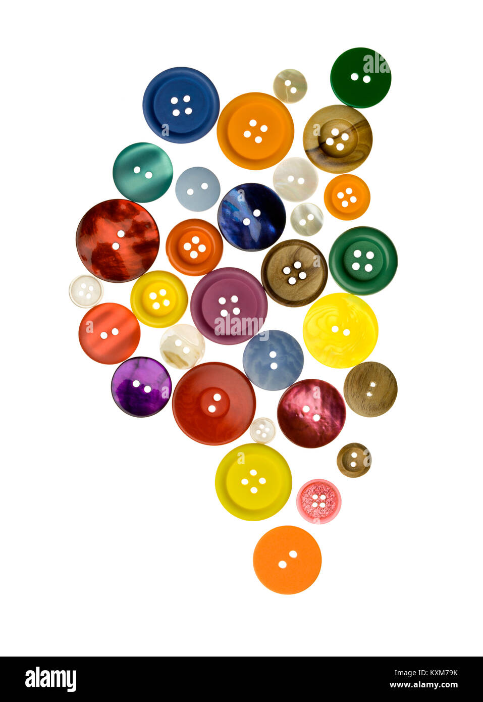 An overhead shot of a selection of various sized buttons. - Stock Image