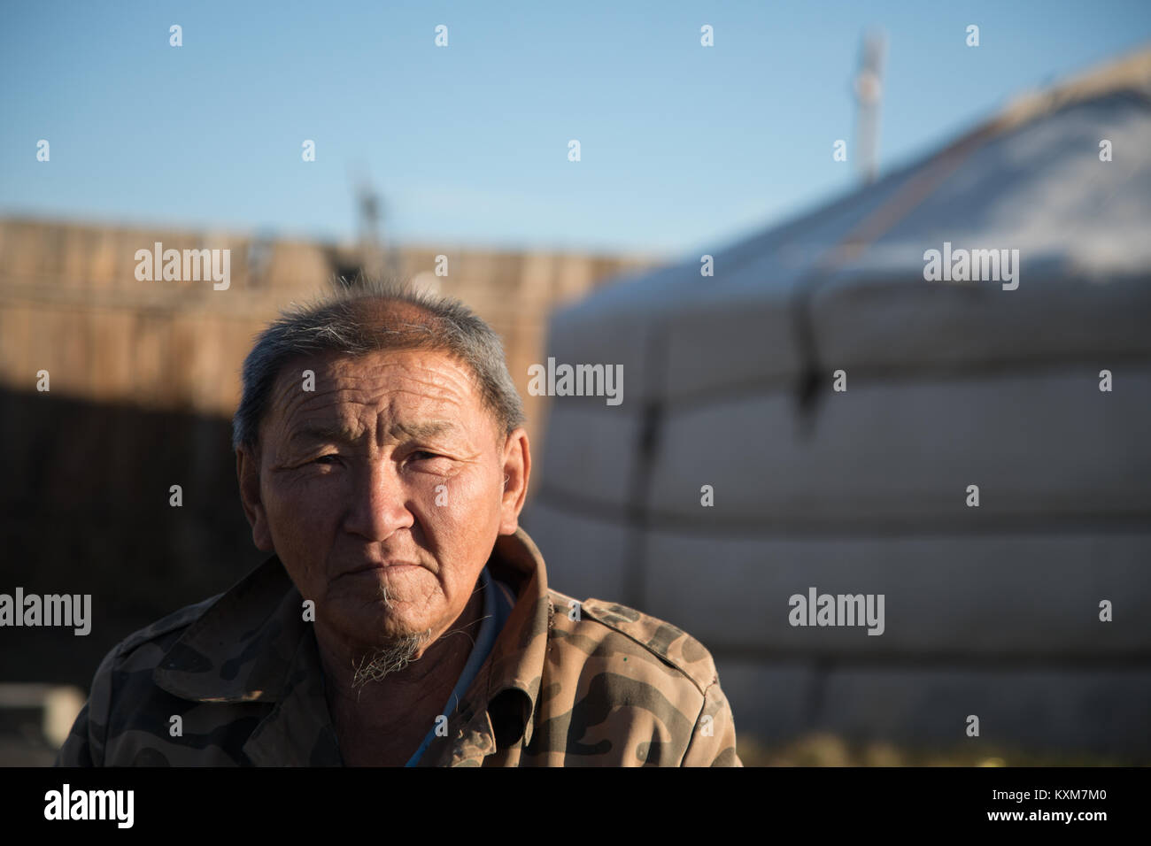 Middle age old man portrait Mongolia ger camp Ulan Bator morning sun rising - Stock Image
