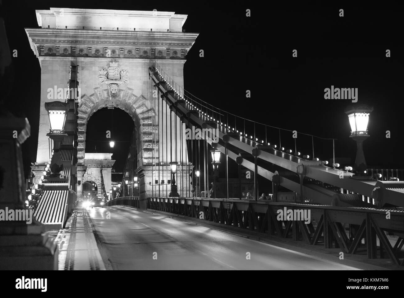 Famous Chain bridge in Budapest at night in black and white - Stock Image