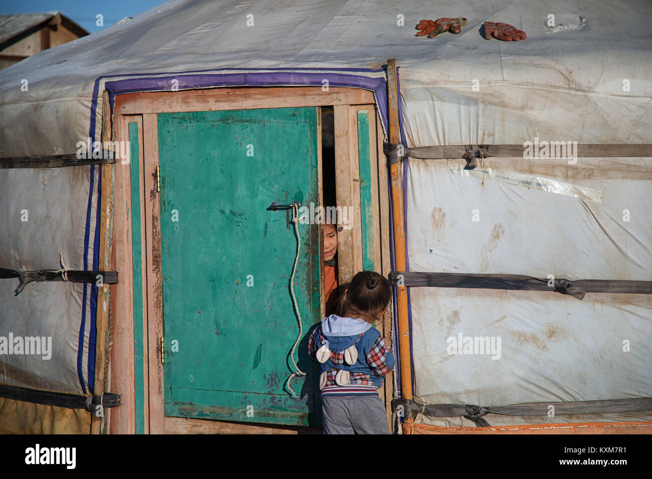 Mongolian ger camp Ulan Bator two little girls playing - Stock Image