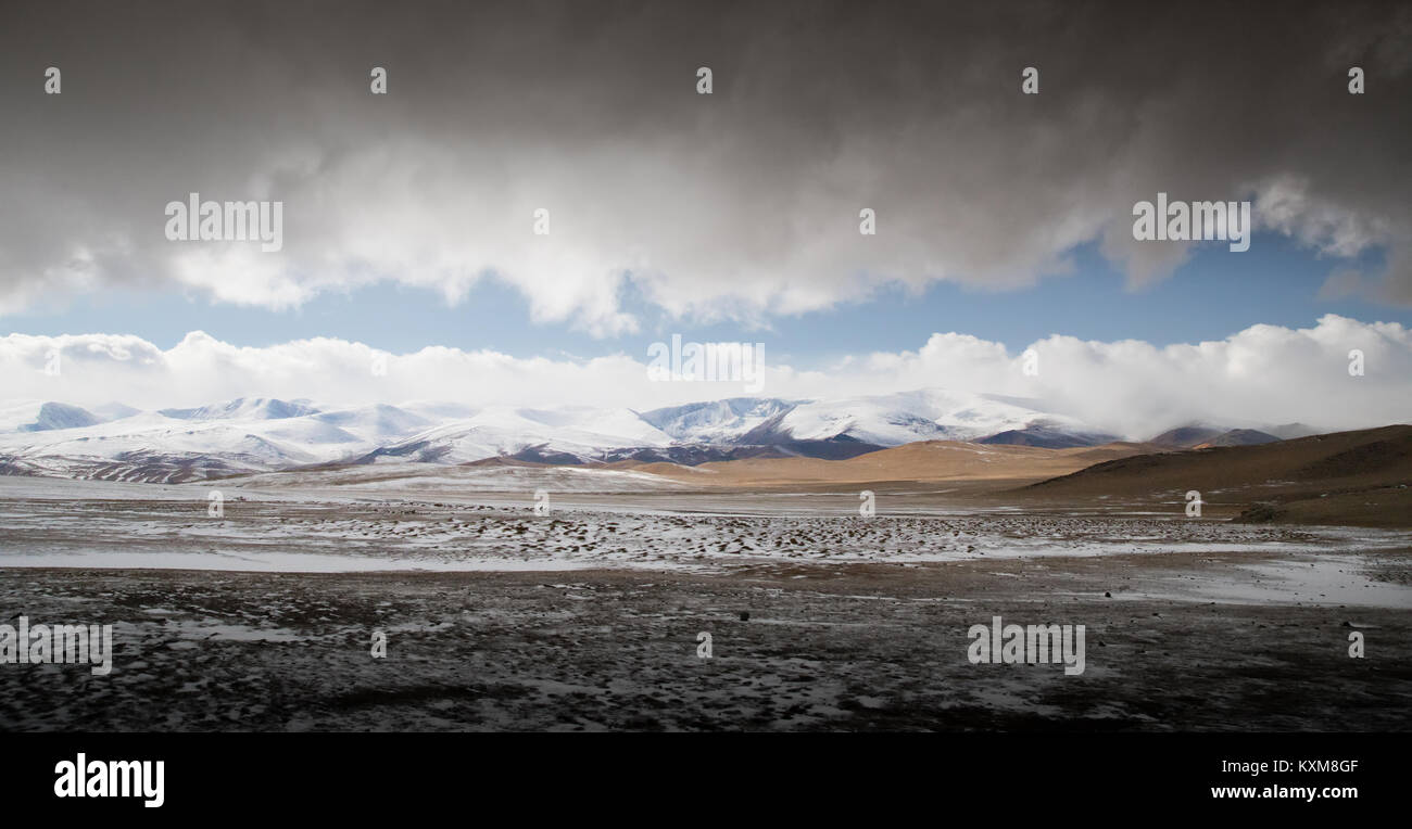 Mongolian landscape snowy mountains snow winter cloudy Mongolia Stock Photo