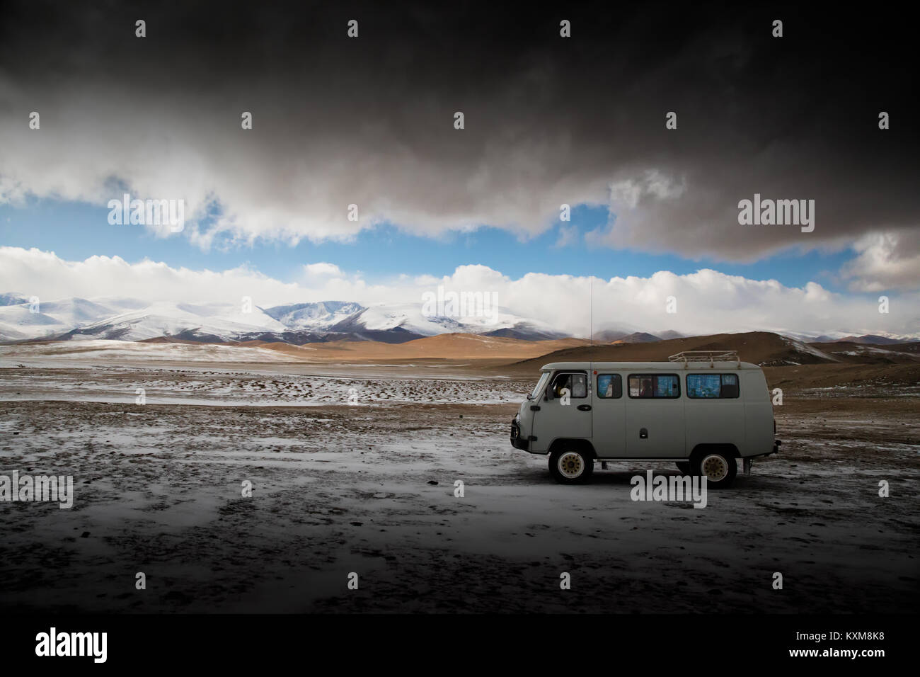 Adventure camping site camper van Russian UAZ 452 Mongolian winter snow - Stock Image