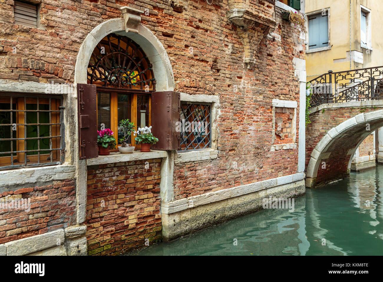 Building facade detail along a small canal in Veneto, Venice, Italy, Europe. - Stock Image