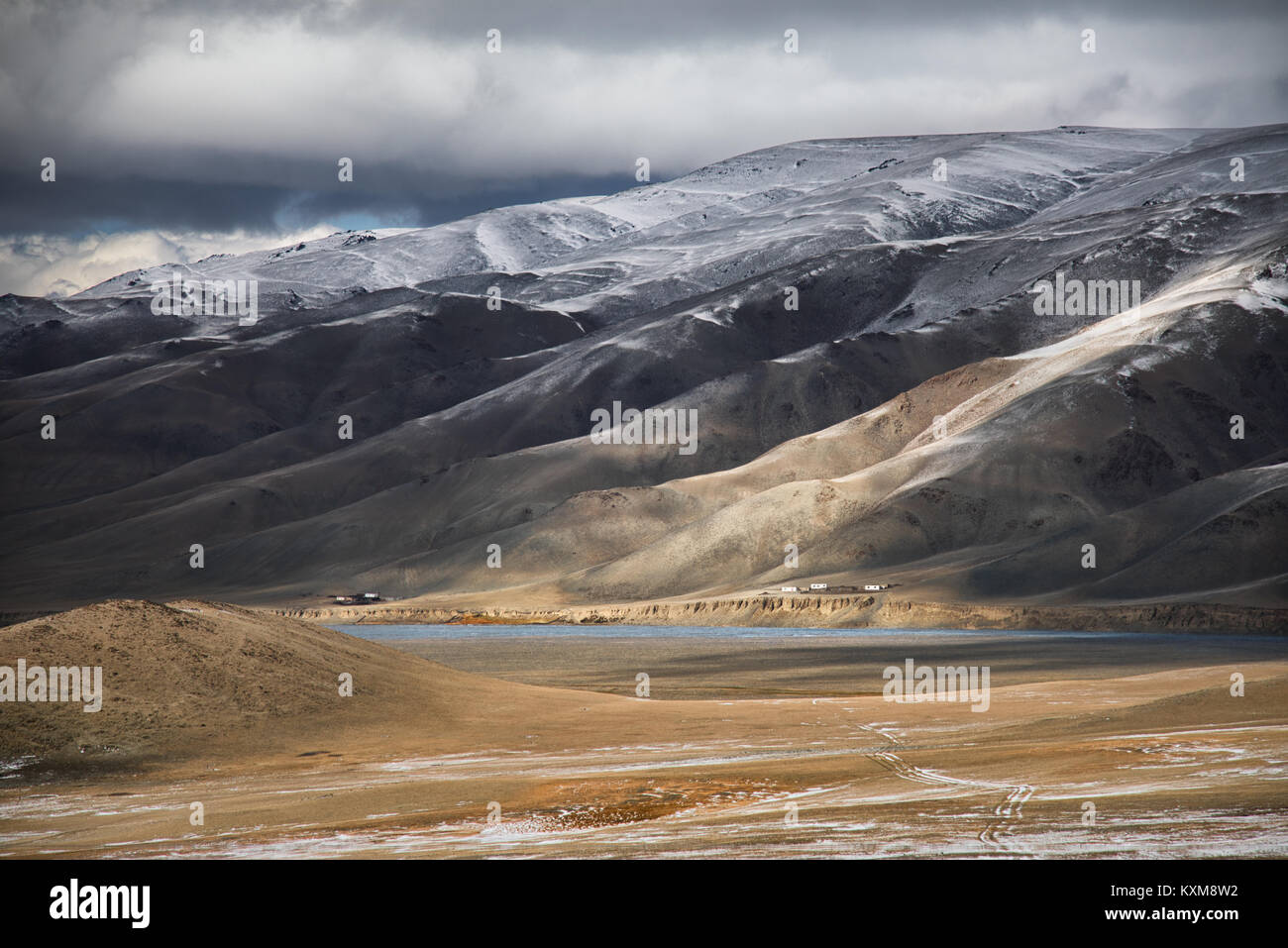 Mongolian landscape snowy mountains snow winter cloudy Mongolia - Stock Image