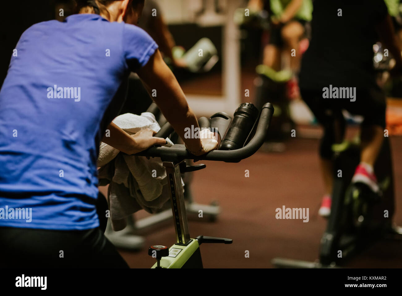 cycling class group. spin class workout - Stock Image