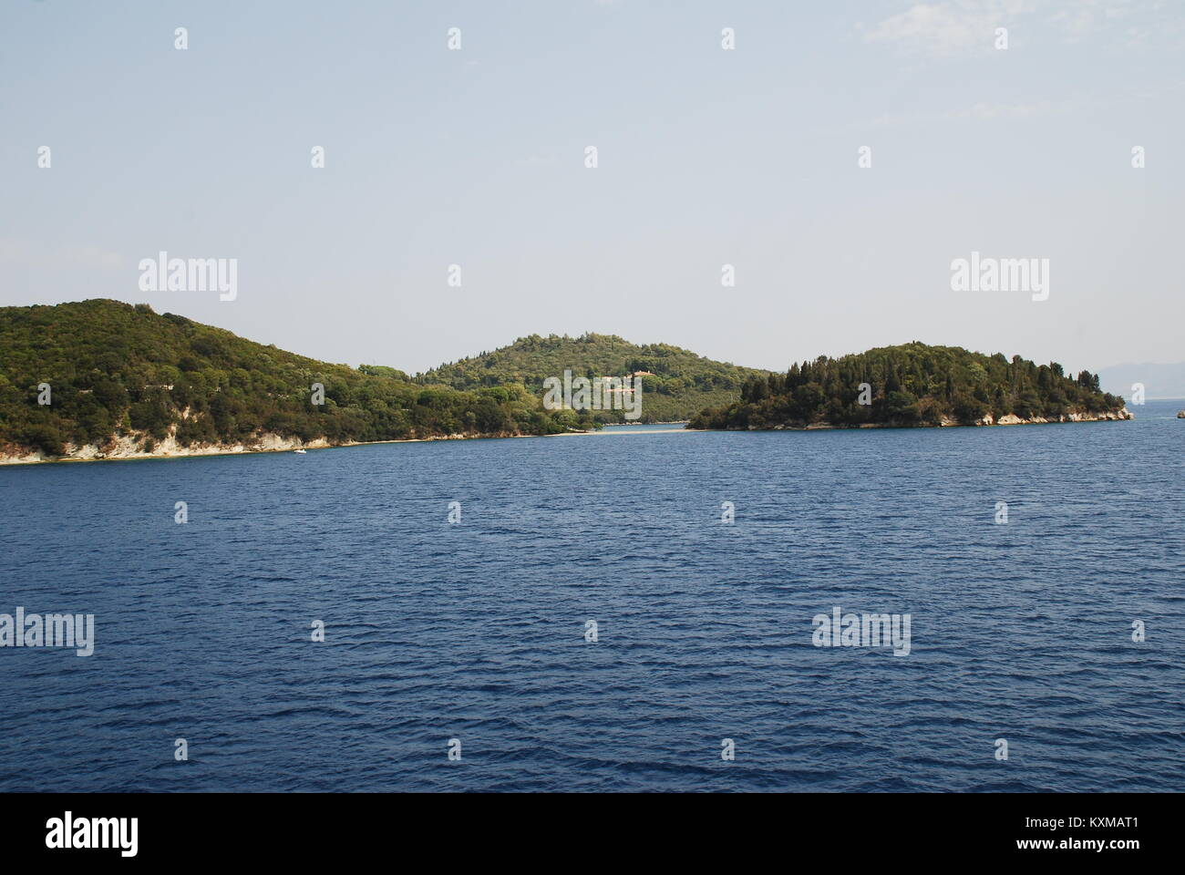 The small island of Skorpios off the coast of Lefkada, Greece. The island is home to the Onassis shipping family. - Stock Image