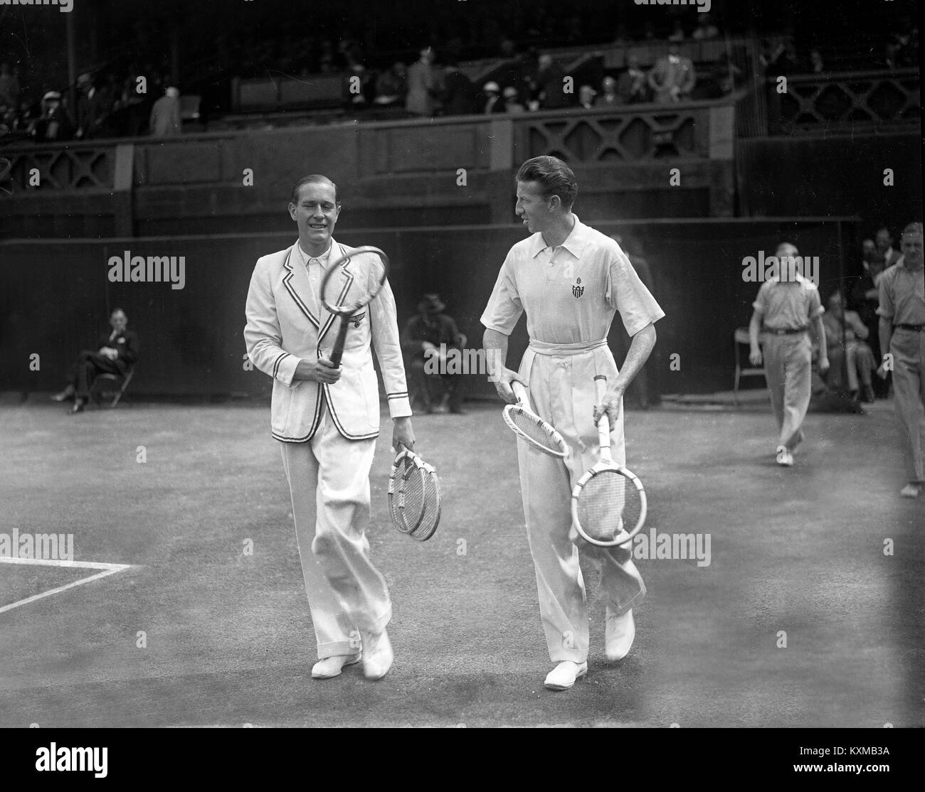 German tennis player Gottfried von Cramm (left) with Don Budge of the USA walking on to the centre court for the - Stock Image