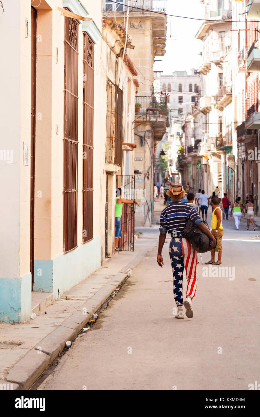 A Cuban man wearing American flag pants in Havana, Cuba. - Stock Image
