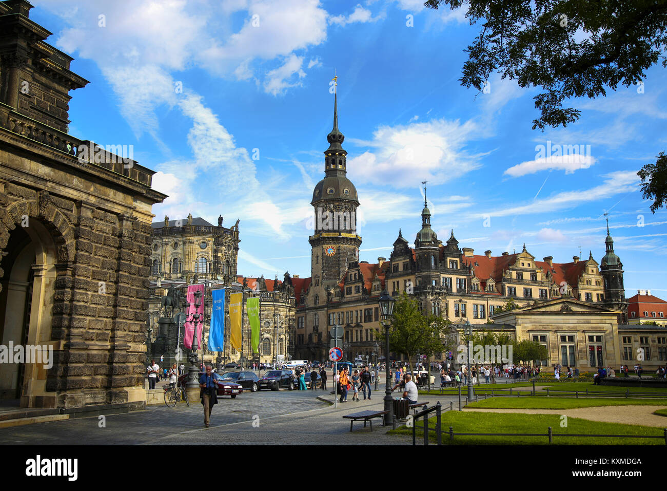 DRESDEN, GERMANY – AUGUST 13, 2016: Tourists walk on Theaterplatz street and majestic view on  Saxony Dresden Castle - Stock Image
