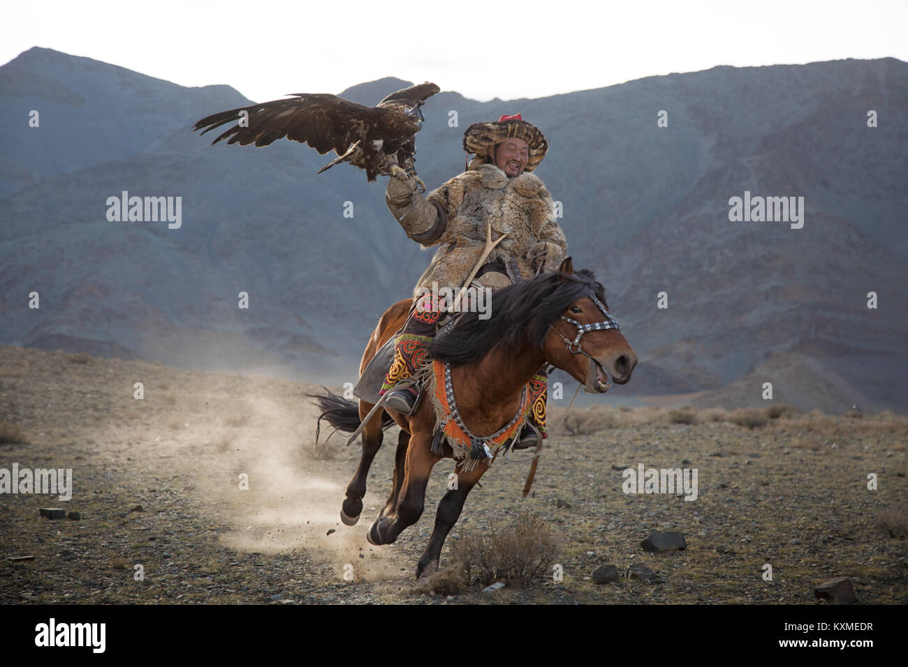 Golden eagle hunter Kazakh eagle festival Bayan Ölgii Ulgii Stock Photo