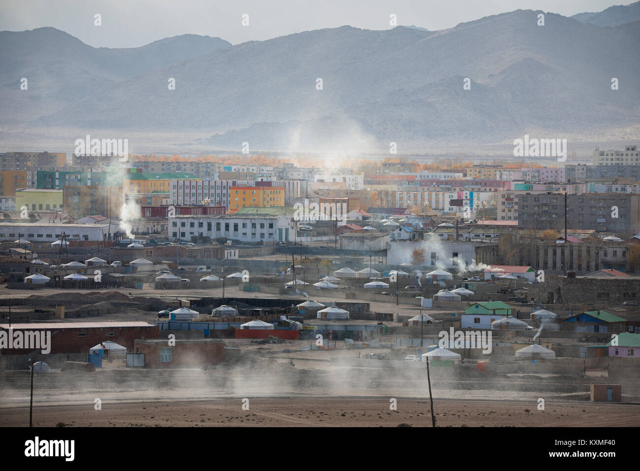 Khovd Hovd view chimney smoke burning coal ger camp gers Mongolia - Stock Image