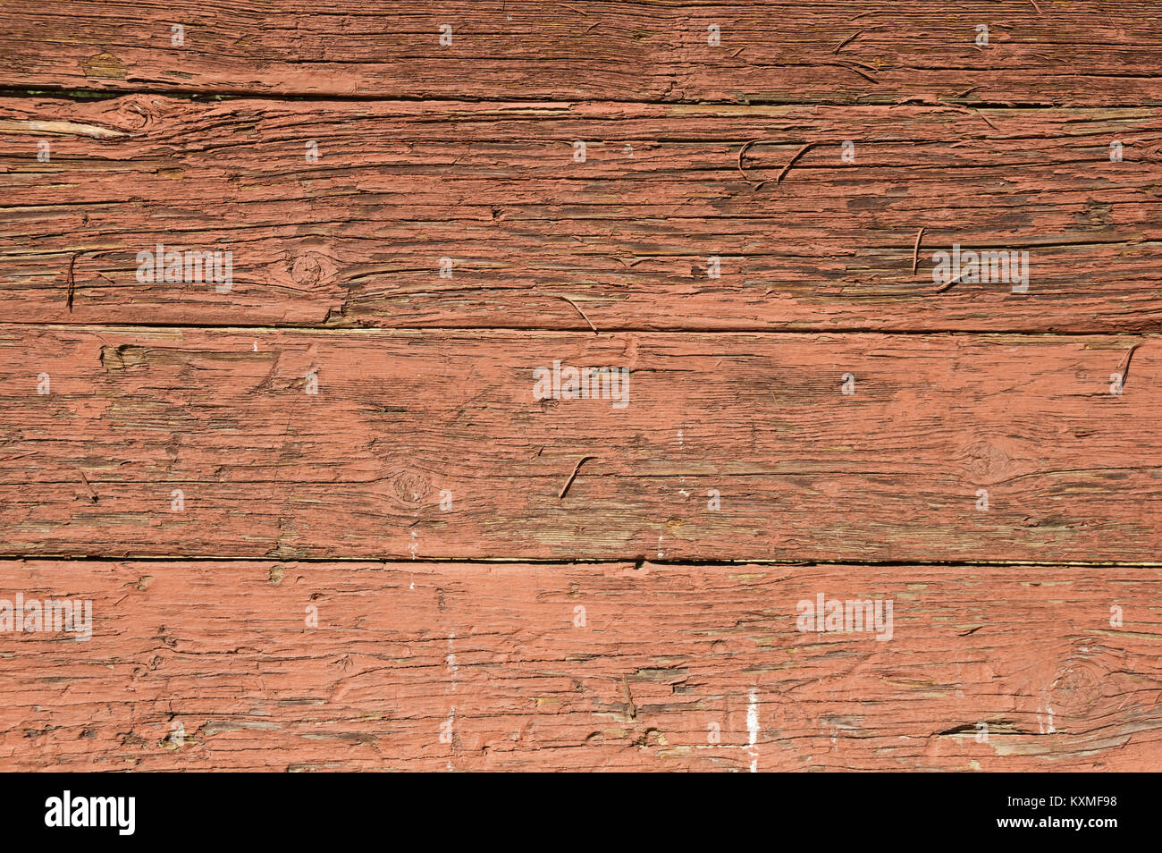 old red painted wood background with cracked and peeling paint - Stock Image