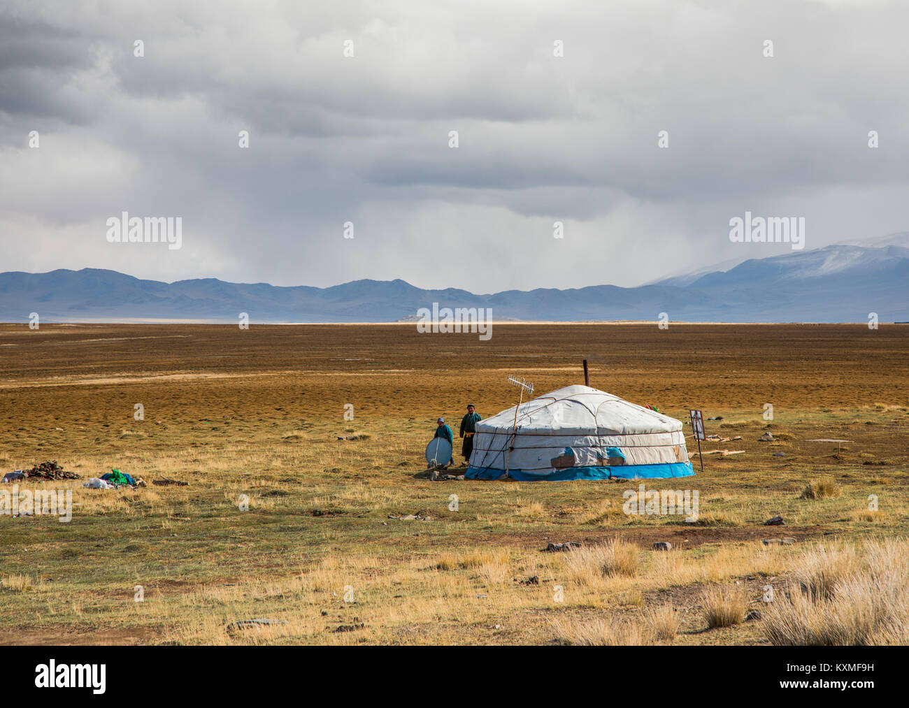 Rural family Mongolia ger father and kid steppes grasslands plains cloudy day - Stock Image