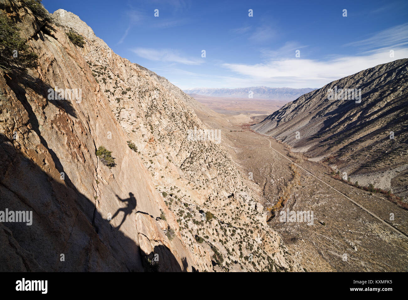 shadow of a rapeller high on a cliff in Pine Creek California - Stock Image
