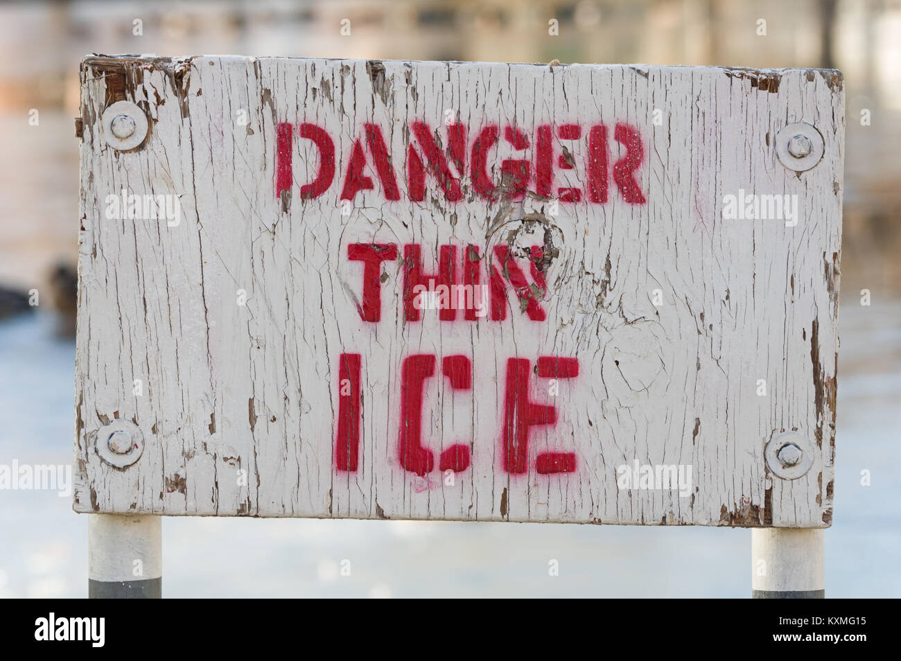 wooden white and red painted danger thin ice sige - Stock Image
