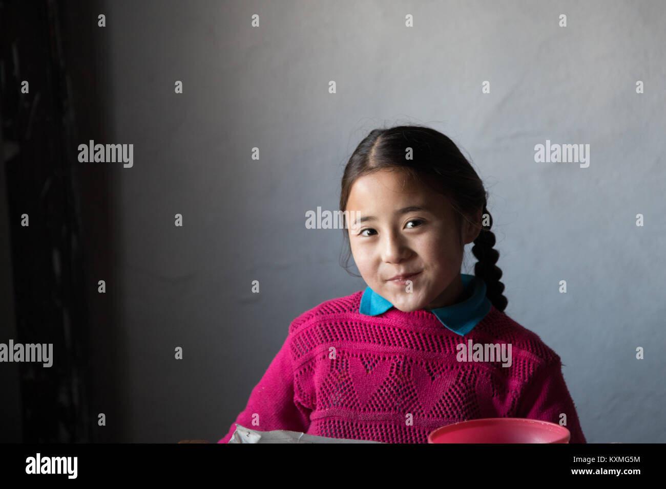 Mongolian kazakh rural country side little girl braids smile - Stock Image