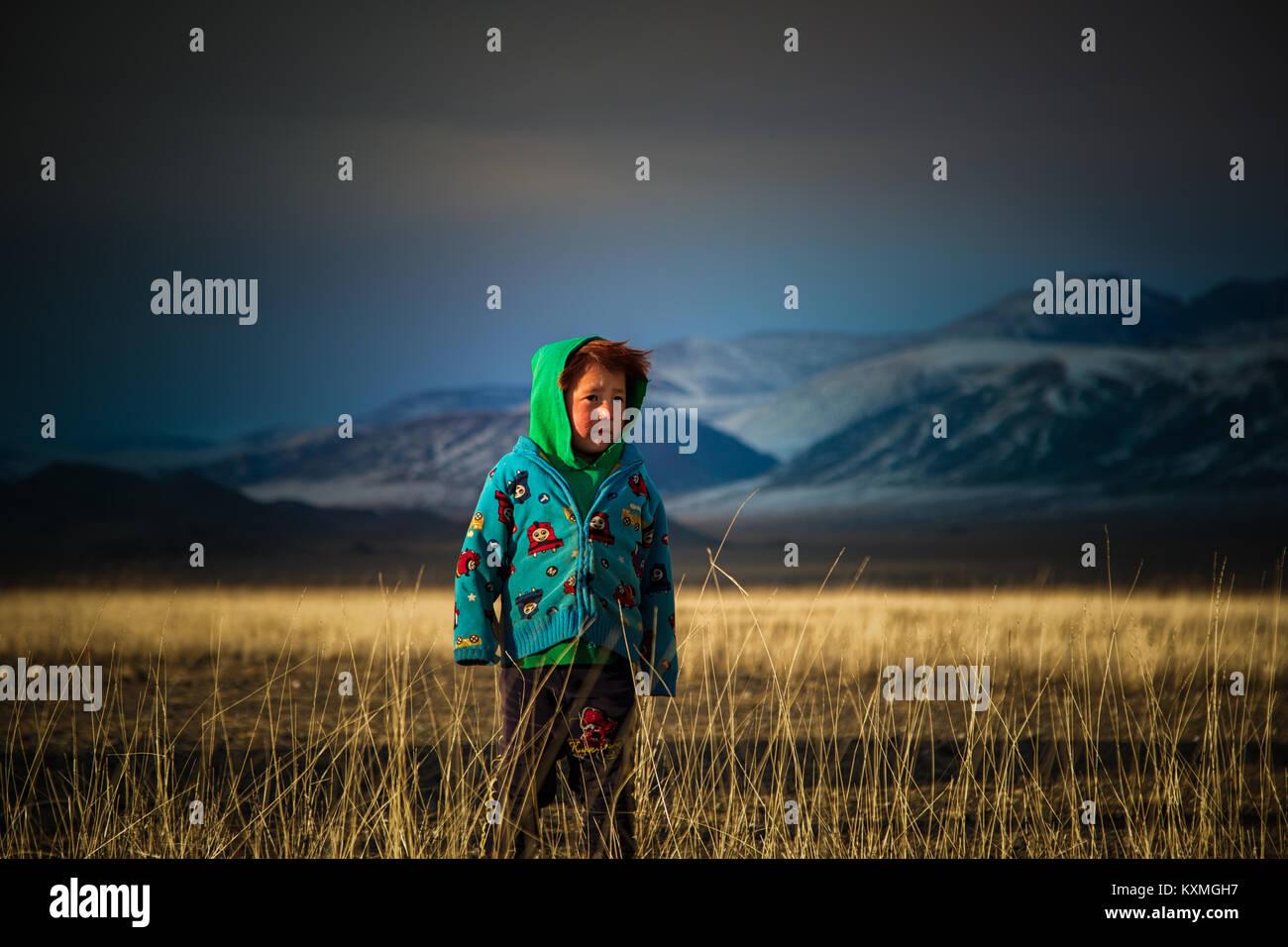 Country side rural kid ginger hair Mongolia steppes grasslands winter - Stock Image